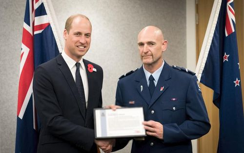 Senior Constable Scott Carmody of Canterbury District Police is shown with Prince William, receiving an award recognising his bravery.