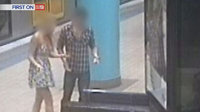 Their train arrives and the pair is confused by the loss of the handbag. (9NEWS)