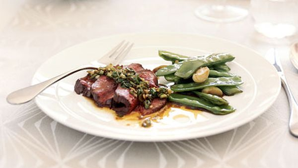 Stir-fried snowpeas with garlic (pictured with roast beef fillet with spring onion, ginger and coriander dressing)