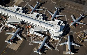 Sydney airport rolls out new virus restrictions as Melbourne route reopens