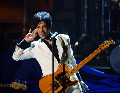 Prince performs after being inducted into the Rock and Roll Hall of Fame in 2004.