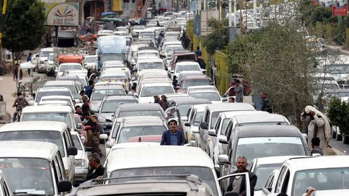 Yemeni drivers wait near their vehicles to reach a petrol station amid an acute shortage of fuel in Sana'a, Yemen.