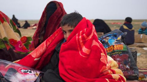 Boys huddle under blankets provided by the Syrian Democratic Forces. Picture: Adam Dobby/CNN