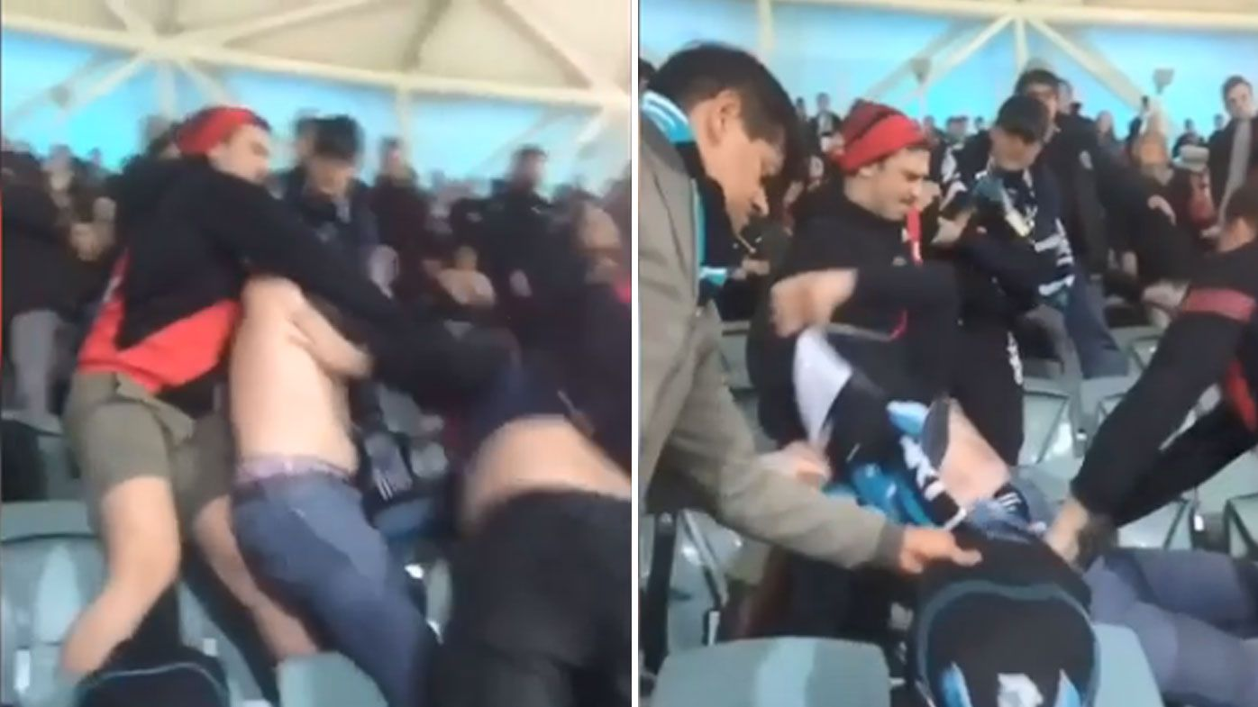 AFL fans caught on video in brawl during Essendon Bombers vs Port Adelaide Power at Adelaide Oval