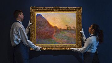 "This undated photo provided by Sotheby's shows Claude Monet's painting titled ""Meules"". The painting, one of Monet's iconic paintings of haystacks, has fetched a record $110.7 million (AUD $160m) at an auction in New York."