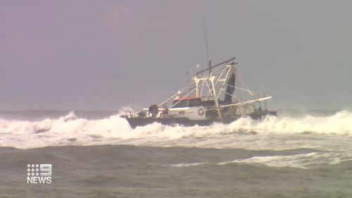 Trawler crew forced to jump into rough Gold Coast waves