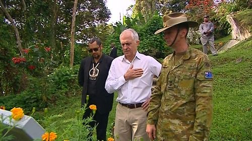 The Prime Minister was given detail accounts of the lives and deaths of a number of Australians honoured at Bomana. (Joel Dry/9NEWS)