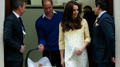 Moments after the presentation, dad William emerged with his daughter in a car seat. The family climbed into the black Range Rover to head back to the palace for some rest. (AAP)