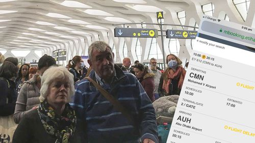 Passengers line up to board one of the few flights out of Morocco, in Marrakech, Thursday, March 19, 2020.