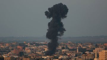 Smoke rises in Gaza after an Israeli rocket strike in the army's most recent offensive. (AAP)