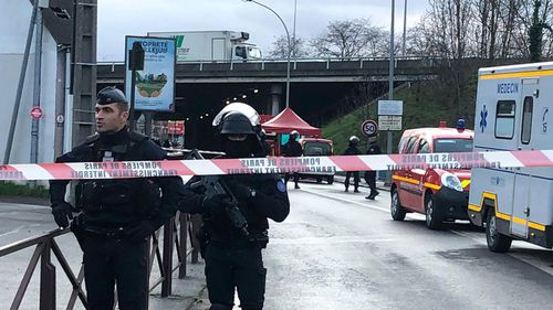 Police officers secure the area after a man attacked passerby Friday Jan.3, 2020 in Villejuif, south of Paris. A man armed with a knife attacked passers-by Friday in a southern Paris park, injuring some, before being shot by police, French officials said.