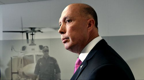 Mr Dutton, pictured at a press conference today, has threatened to expose Labor ministers.
