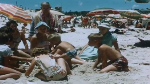 A day at the beach. Picture: State Library of Queensland Reel Rescue