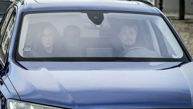 Danish Crown Prince Frederik, Princess Mary, and children arrive by car at Fredensborg Palace (Image: AAP)