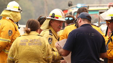 Firefighters battle bushfires in Busbys Flat, northern NSW, Wednesday, October 9, 2019. (AAP Image/Jason O'Brien) NO ARCHIVING (AAP)