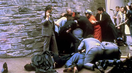 James Brady, lying on the ground in this shot, was wounded in the assassination attempt. (AP)