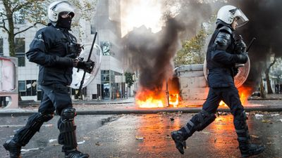 Riot police armed with clubs and shields charged the rowdiest groups of demonstrators, who also set rubbish bins on fire and made makeshift barricades. (AAP)