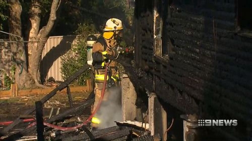 Fire crews battle the blaze on Currong Street in Kenmore. (9NEWS)