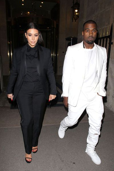 <p>Kim Kardashian and Kanye West step out in black and white suits for a Givenchy show in Paris in March 2013.</p> <p> </p>