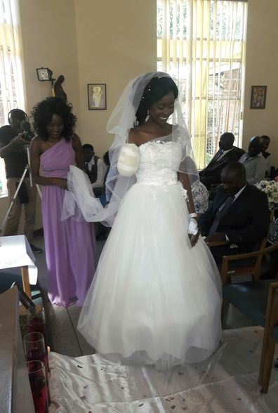 "In this photo taken on Saturday, May, 5, 2018, Zenele Ndlovu walks down the aisle on her wedding day at a hospital Chapel in Bulawayo, Zimbabwe. Ndlovu and Jamie Fox, attacked by a crocodile, wedded days later in a Zimbabwean hospital, where Ndlovu was recovering after losing an arm. ""In one week we went from shock and agony to a truly amazing experience,"" Fox told The Associated Press on Monday, May 7. (AP Photo)"