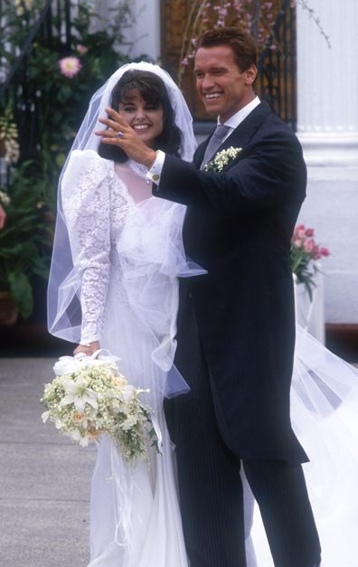 Actor Arnold Schwarzenegger with his new wife Maria Shriver outside St. Francis Xavier Church after their wedding on April 26, 1986 in Hyannis, Massachusetts.