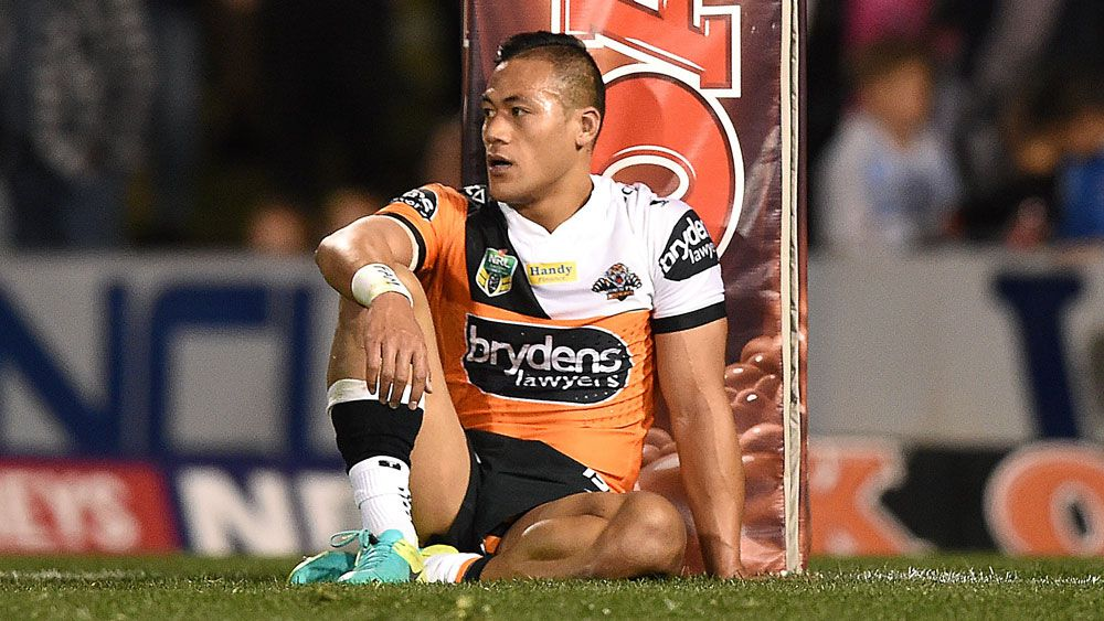 Wests Tigers centre Tim Simona has received interest from another NRL club but wants to stay put. (AAP)