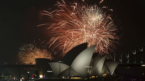 Fireworks explode over Sydney's iconic Opera House on New Year's Eve 2014. (AAP)