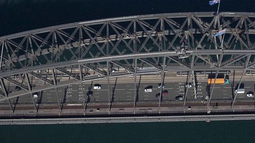 An aerial view of the Sydney Harbour Bridge on April 22, 2020 in Sydney, Australia. Stay-at-home orders have seen a reduction in traffic on the normally busy bridge. (Photo by Ryan Pierse/Getty Images)