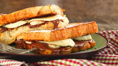 """Recipe: <a href=""""https://kitchen.nine.com.au/2017/11/07/09/35/toasted-banana-nutella-sandwich"""" target=""""_top"""">Toasted banana Nutella sandwich</a>"""