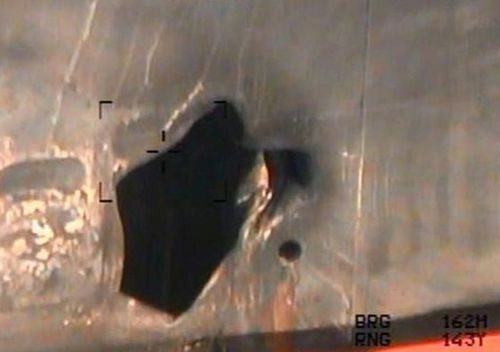 This image released by the US Department of Defence, taken from a US Navy helicopter, shows what the Navy says is blast damage to the motor vessel M/T Kokuka Courageous, consistent with a limpet mine attack.