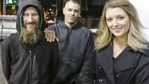 Johnny Bobbitt Jr., left, Kate McClure, right, and McClure's boyfriend Mark D'Amico. (Elizabeth Robertson/The Philadelphia Inquirer via AP and AAP)