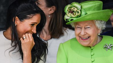 Meghan Markle and Queen Elizabeth laughing together.