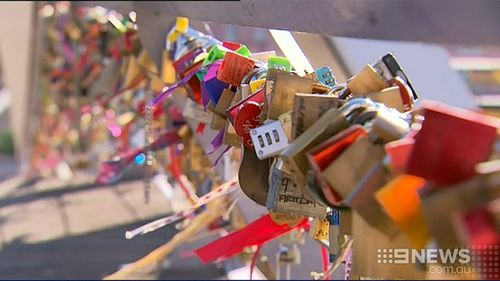 Lovers' locks saved from Victorian bridge