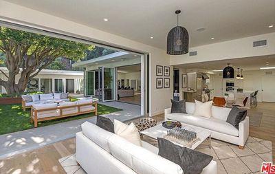 The five-bedroom, fivebathroom property has great indoor/outdoor flow.