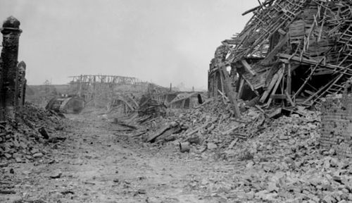 A shattered street in the village of Le Hamel in France shortly after the battle. (Photo: AWM).