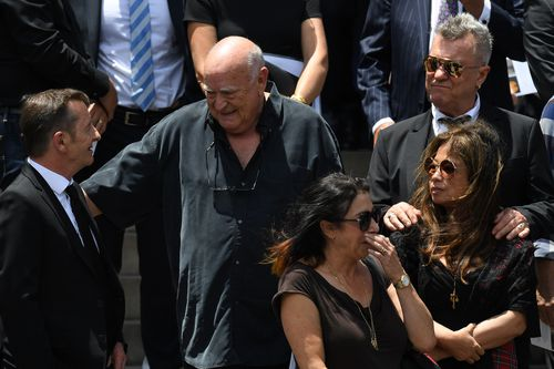Jimmy Barnes, promoter Michael Chugg outside after the service. Picture: AAP