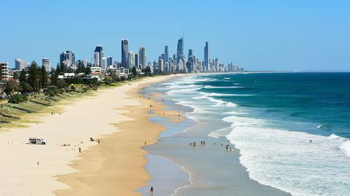 Surfers Paradise swimmer pulled from water, treated by paramedics