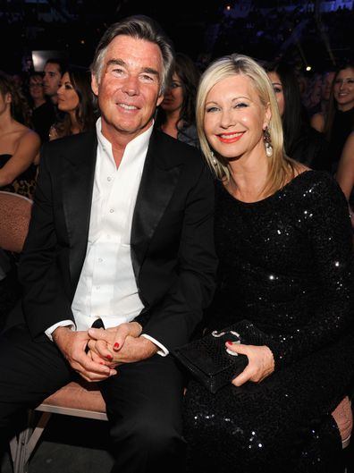 Singer Olivia Newton-John and husband John Easterling attend the 2013 American Country Awards at the Mandalay Bay Events Center on December 10, 2013 in Las Vegas, Nevada.