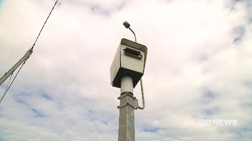 Police in Adelaide are hunting a man who tried to torch a speed camera in the city's west.