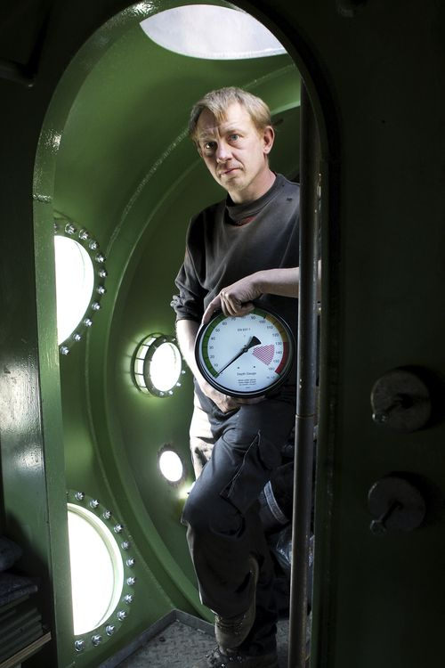 The submarine owner stands inside a vessel in 2008.