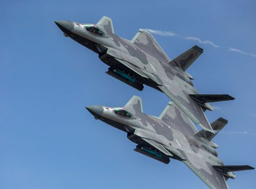 Two Chinese J-20 fighters flew over crowds at the Zuihai Air Show.