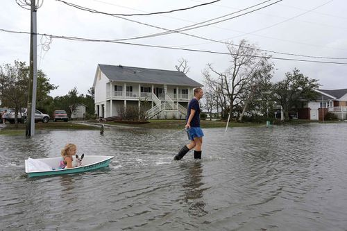 A woman pulls her daughter along in a boat in Davis, North Carolina.
