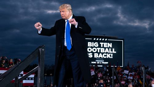 President Donald Trump dances after speaking during a campaign rally in Circleville, Ohio.