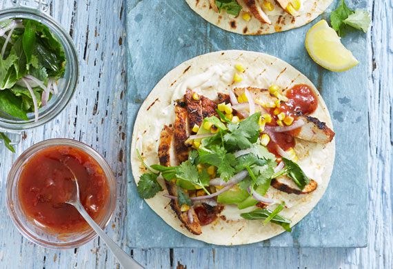 Smoky chargrilled chicken tortillas with grilled corn and herb salad