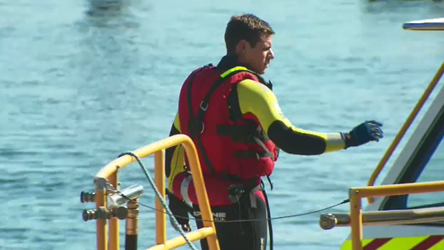 Detectives found the body floating in the water. (9NEWS)