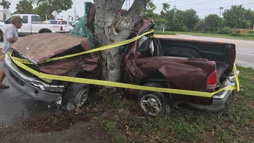 A man died when his car slammed into a tree from strong winds near Key West. (AFP)
