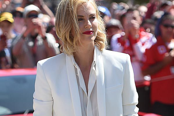 Charlize Theron arrives at the Albert Park street circuit for the Australian Formula One Grand Prix in Melbourne on Sunday, March 15 , 2015. (AAP)