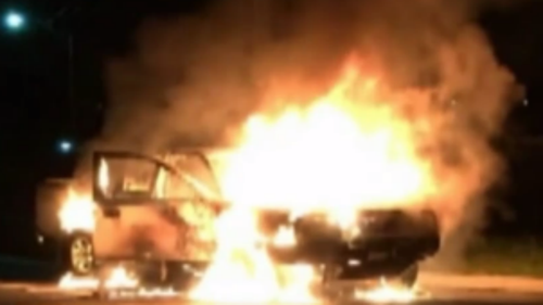 A Nissan Navara ute was torched after the alleged robbery. (9NEWS)