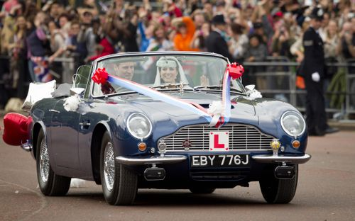 Of course, the princess's cousin, Prince William, was pictured after his wedding to Kate Middleton entertaining crowds in an Aston Martin, a DB6 Vantage Volante.