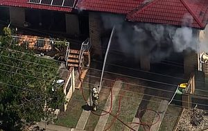 Two teenagers taken to hospital after house fire north of Brisbane
